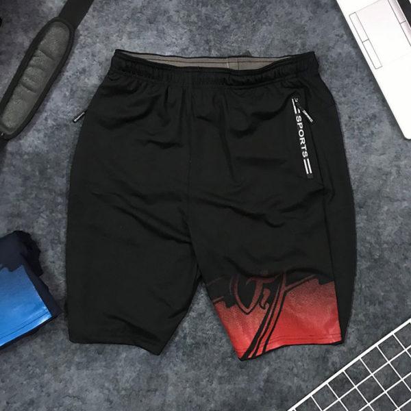Quần short nam thể thao Sport cách điệu sắc màu ở ống phải viền đỏ